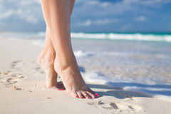 Closeup of woman legs on sea shore Royalty Free Stock Photography