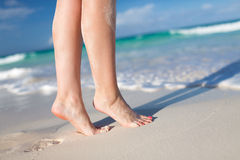 Closeup of woman legs on sea shore Royalty Free Stock Photos