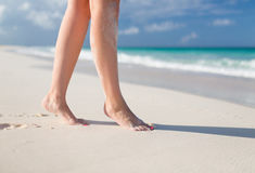 Closeup of woman legs on sea shore Royalty Free Stock Photo