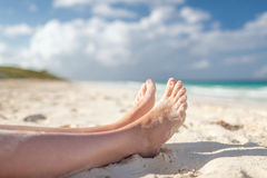 Closeup of woman legs on sea shore Royalty Free Stock Images
