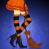 Closeup of woman legs in sexy Halloween witch costume. Illustration of closeup of woman legs in sexy Halloween witch costume Stock Photo