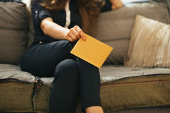 Closeup on woman with letter in loft apartment Stock Photos