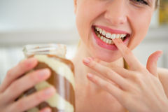 Closeup on woman licking chocolate butter Stock Image