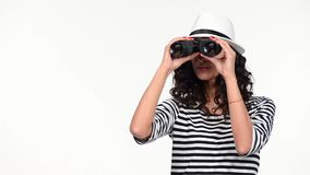 Closeup of woman looking through binoculars stock video footage