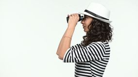 Closeup of woman looking through binoculars stock video