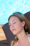 Closeup of woman lying in long chair Royalty Free Stock Photography