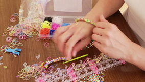 Closeup of woman makes braslets with elastic bands. Closeup of woman makes braslets with elastic rainbow loom bands stock video footage