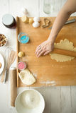 Closeup of woman making dough for holiday cookies on wooden desk Royalty Free Stock Photography