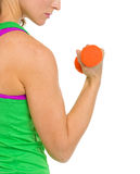 Closeup on woman making exercise with dumbbells Royalty Free Stock Photography