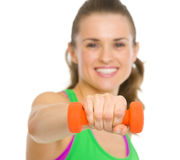 Closeup on woman making exercise with dumbbells Royalty Free Stock Images