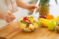 Closeup on woman making fruits salad Stock Photography