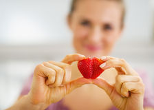 Closeup on woman making heart with strawberry Royalty Free Stock Photo