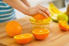 Closeup on woman making orange juice Stock Photo