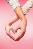 Closeup of woman and man hands showing heart shape Stock Photography