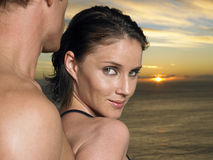 Closeup Of Woman With Man By Ocean At Sunset Stock Photography