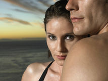Closeup Of Woman With Man By Ocean At Sunset Royalty Free Stock Photos