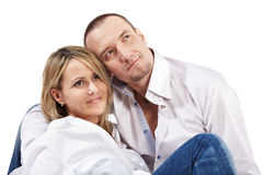 Closeup woman and man sit on floor Stock Images