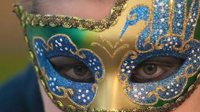 Closeup of woman in mask winking. stock footage
