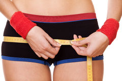 Closeup woman measuring hips 90 centimeters Stock Images