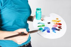 Closeup of woman mixing paint on palette Royalty Free Stock Images