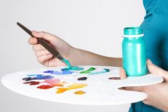 Closeup of woman mixing paint on palette Stock Photography