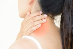 Closeup woman neck and shoulder pain and injury. Health care and stock image