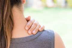 Closeup woman neck and shoulder pain and injury. royalty free stock photo