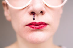 Closeup of woman with nosebleed Royalty Free Stock Photo
