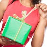 Closeup of woman opening box gift. Christmas. Stock Photo