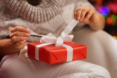 Closeup on woman opening Christmas present box Royalty Free Stock Photo