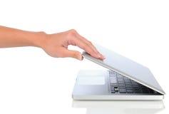 Closeup of woman opening laptop Stock Photography