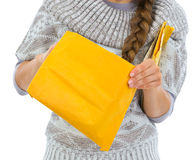 Closeup on woman opening letter Royalty Free Stock Photo