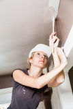Closeup of Woman Painting the Ceiling Stock Photo