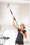 Closeup of Woman Painting the Ceiling Royalty Free Stock Image
