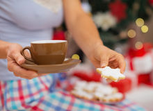 Closeup on woman in pajamas holding hot beverage Stock Image