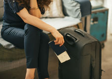 Closeup on woman with passport, ticket and luggag Royalty Free Stock Photos