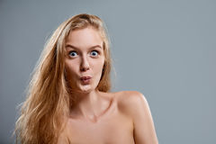 Closeup of woman playfully making funny face Royalty Free Stock Image