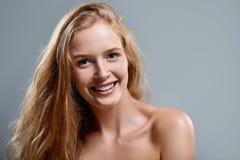 Closeup of woman playfully winking at camera Stock Photography