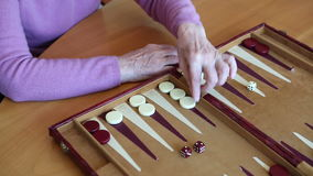 Closeup of  woman playing backgammon stock video