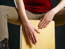 Closeup of a woman playing the Cajon Stock Image