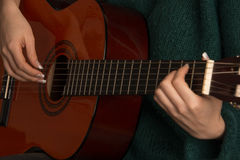Closeup of woman playing guitar Royalty Free Stock Image