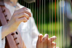 Closeup of a Woman playing a Harp Royalty Free Stock Photo