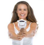 Closeup on woman pointing hairdryer in camera Royalty Free Stock Photos