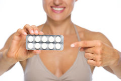 Closeup on woman pointing on package of pills Stock Photo