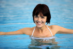 Closeup of woman in pool. Closeup of beautiful young woman in a swimming pool Royalty Free Stock Photography