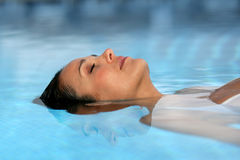 Closeup of woman in pool. Closeup of young woman with eyes shut in a pool Stock Photos