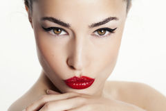 Closeup woman portrait with red lips and black eyeliner. Woman beauty portrait with red lips and black eyeliner, studio white royalty free stock image
