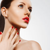 Closeup woman portrait with red nails and lips Royalty Free Stock Photos