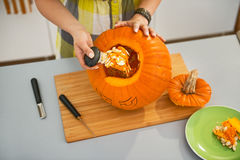 Closeup on woman prepare big orange pumpkin for Halloween party Royalty Free Stock Images