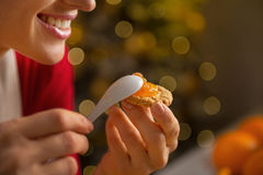 Closeup on woman putting orange jam on cookie Royalty Free Stock Photos